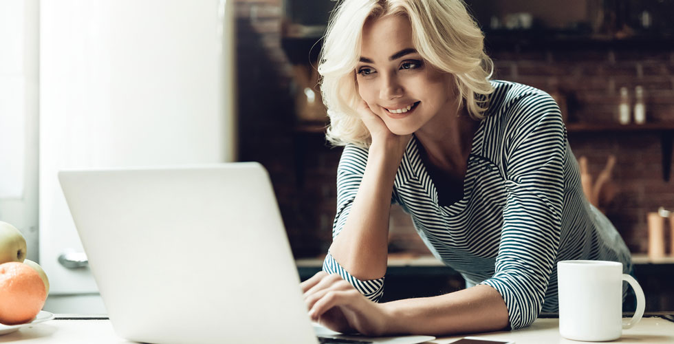 Blond_Woman_Looking_at_Laptop